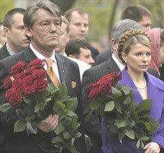 Ukrainian President Viktor Yushchenko, left, and Prime Minister Yulia Tymoshenko, right, take part in a ceremony in Kyiv, Ukraine, Tuesday commemorating the 19th anniversary of the Chornobyl nuclear disaster. (AP Photo/Sergei Chuzavkov)