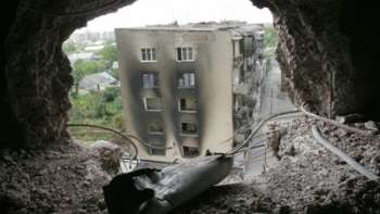 A shell casing lies inside a destroyed building in South Ossetia
