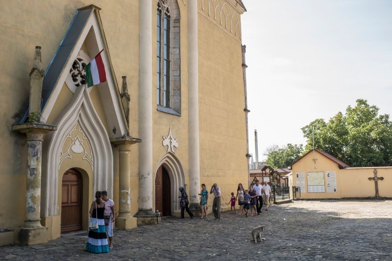 The Hungarian flag flies on the front of the local Roman Catholic Church