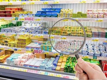 Смесь из неизвестных составляющих: АМКУ оштрафовал 6 производителей «молочки» на 111 млн грн