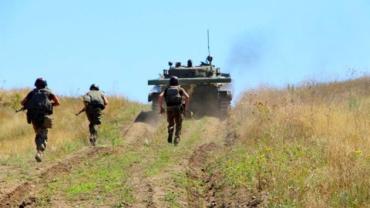 В Донбассе начался отвод войск