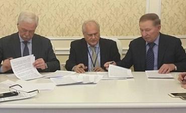 От Украины решение подписал Леонид Кучма, ОБСЕ - Мартин Сайдик, России - Грызлов