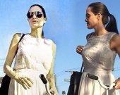 Хрупкость Анджелины подчеркивает легкий белый сарафан свободного кроя