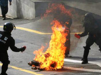В центре Пекина три человека совершили акт самосожжения