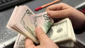 Доллар за день подорожал на 50 копеек